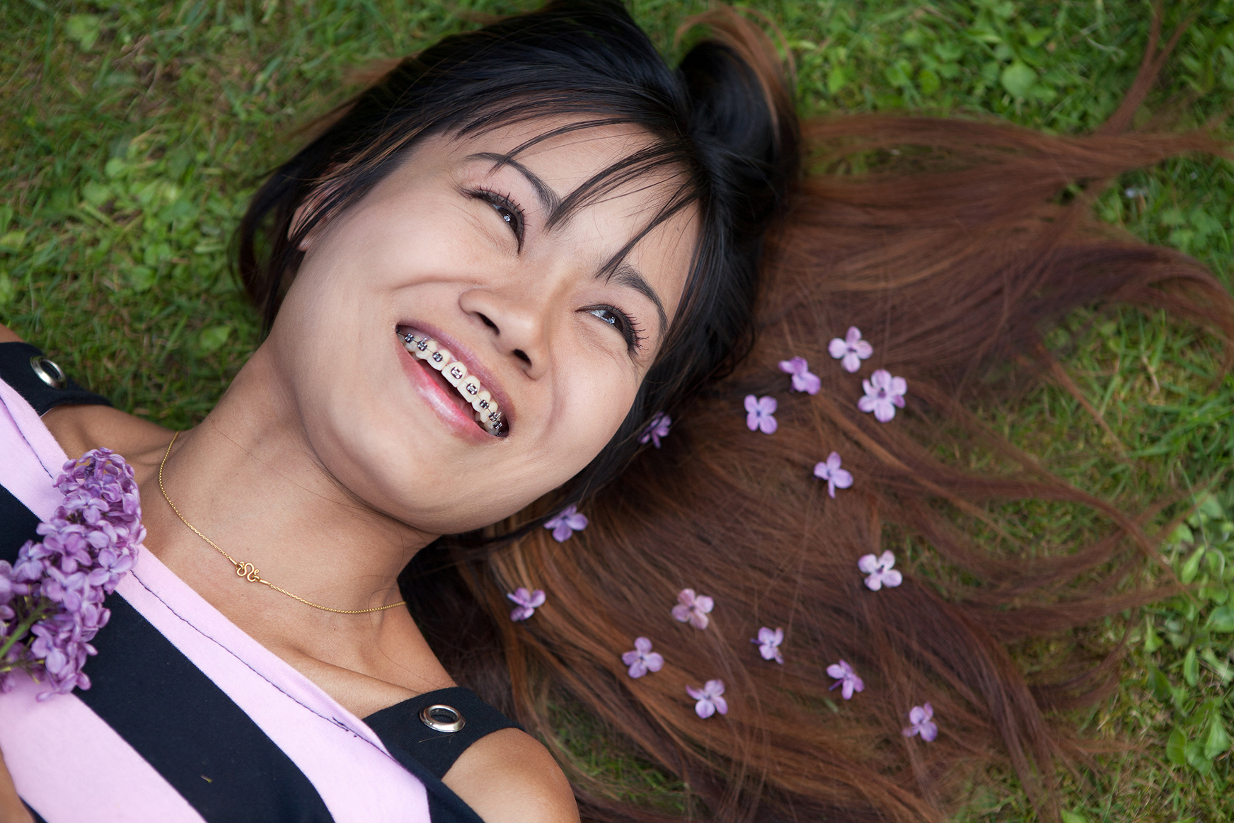 photodune-1613473-thai-womanwith-a-big-smile-laying-on-the-grass-l